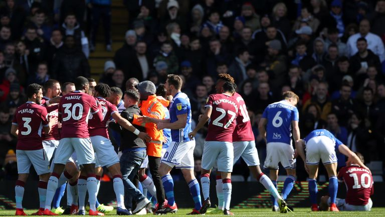 A fan attacks Aston Villa s Jack Grealish on the pitch (right) during last  week s e26c7f7a9