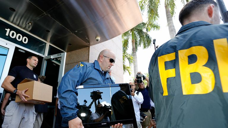 FBI agents carry boxes and computers from the headquarters of CONCACAF after it was raided in Miami Beach, Florida, in 2015