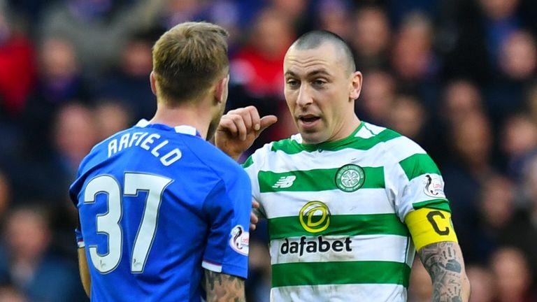 Celtic captain Scott Brown exchanges words with Rangers' Scott Arfield