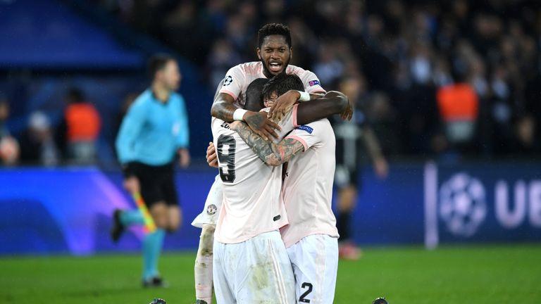 Fred embraces Romelu Lukaku and Victor Lindelof