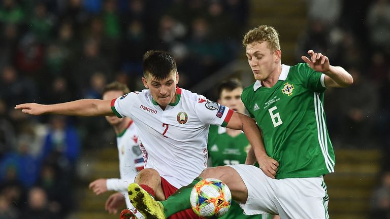 George Saville of Northern Ireland and Stanislav Dragun of Belarus battle for the ball during the 2020 UEFA European Championships Group C qualifying match between Northern Ireland and Belarus at Windsor Park on March 24, 2019 in Belfast, United Kingdom