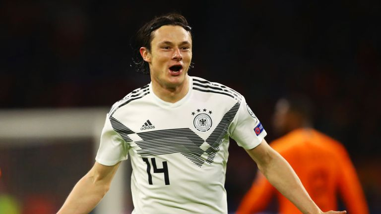 Nico Schulz celebrates his late winner over the Netherlands