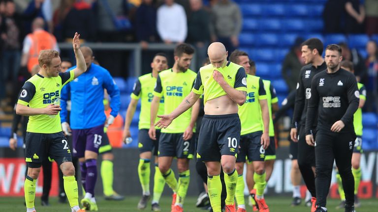 Huddersfield Town players look dejected following a 2-0 defeat to Crystal Palace. One of three results that confirmed the club's relegation from the Premier League
