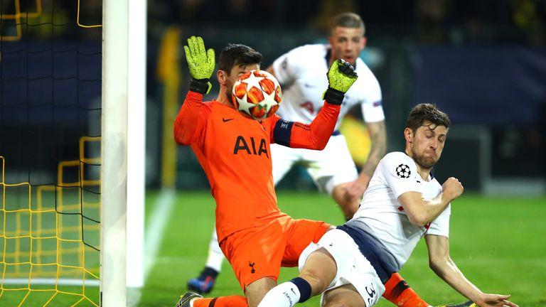 Hugo Lloris and Ben Davies contrive to keep out Dortmund's Julian Weigl