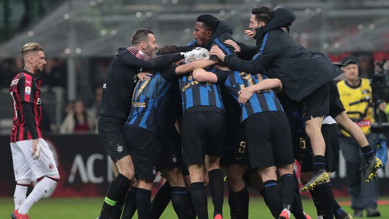 Inter Milan's players celebrate their win over local rivals AC Milan.