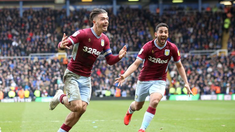 Aston Villa's Jack Grealish (left) celebrates scoring his sides first goal of the game during the Sky Bet Championship match at St Andrew's Trillion Trophy Stadium, Birmingham.