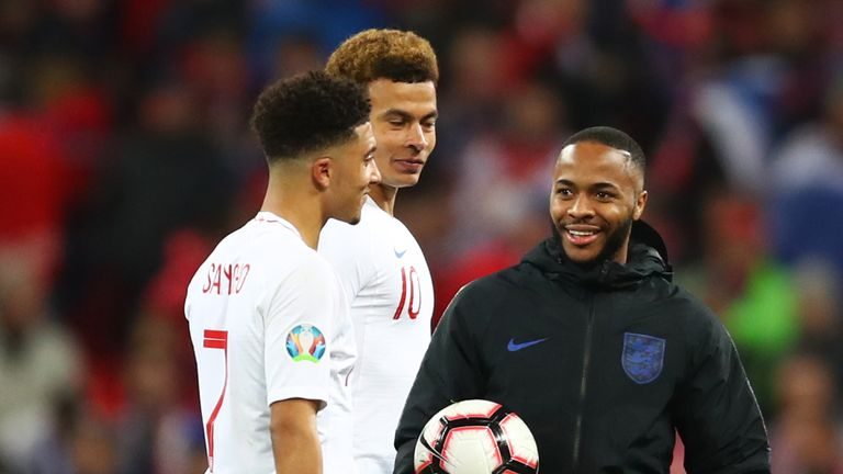 Raheem Sterling talks to Jadon Sancho and Dele Alli after his hat-trick on Friday night