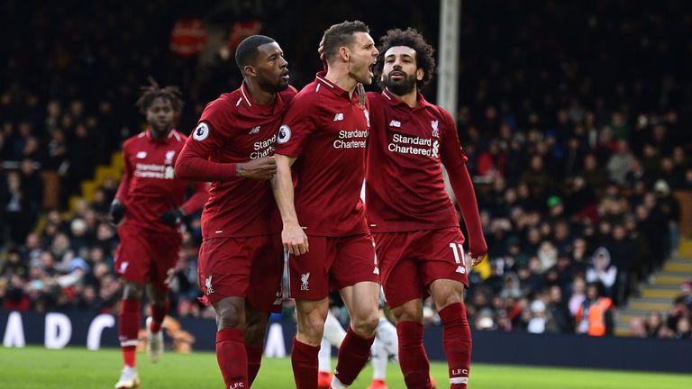 Liverpool's English midfielder James Milner (C) celebrates scoring the team's second goal during the English Premier League football match between Fulham and Liverpool at Craven Cottage in London on March 17, 2019.