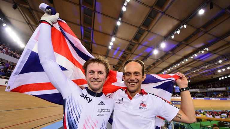 Jason Kenny of Great Britain celebrates with coach Justin Grace