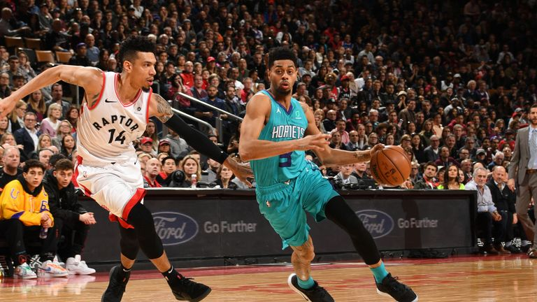 Jeremy Lamb #3 of the Charlotte Hornets drives through the paint during the game against Danny Green #14 of the Toronto Raptors on March 24, 2019 at the Scotiabank Arena in Toronto, Ontario, Canada.