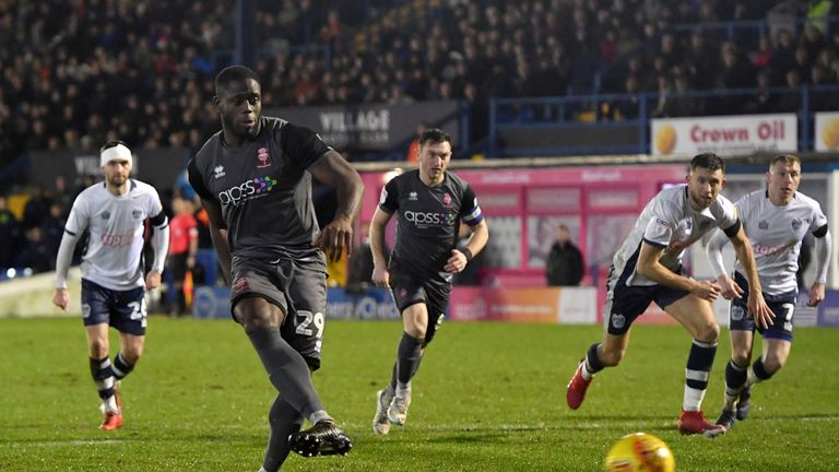 John Akinde scored the equaliser from the penalty spot for Lincoln