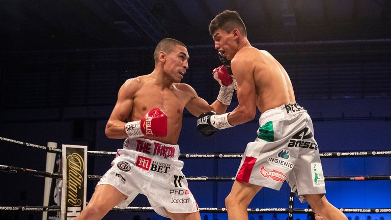 Gill Stops Dominguez in Three Rounds