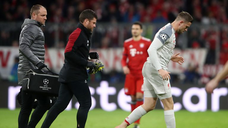 Jordan Henderson leaves the pitch after removing his left boot