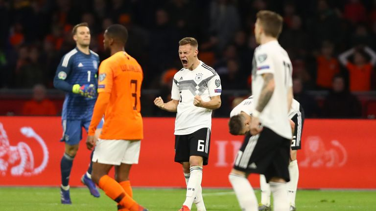 Joshua Kimmich celebrates victory with team-mate Leon Goretzka after the 2020 UEFA European Championships Group C qualifying match between Netherlands and Germany at Johan Cruyff Arena on March 24, 2019 in Amsterdam, Netherlands