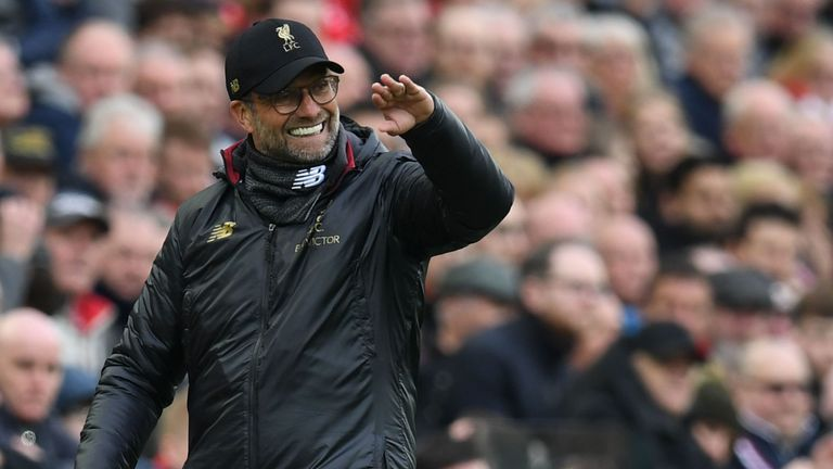 Jurgen Klopp encourages his Liverpool team during the match with Tottenham