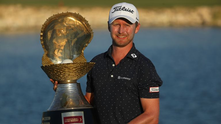 Justin Harding proudly displays the Qatar Masters trophy