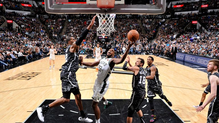 Khris Middleton of the Milwaukee Bucks shoots the ball against the San Antonio Spurs