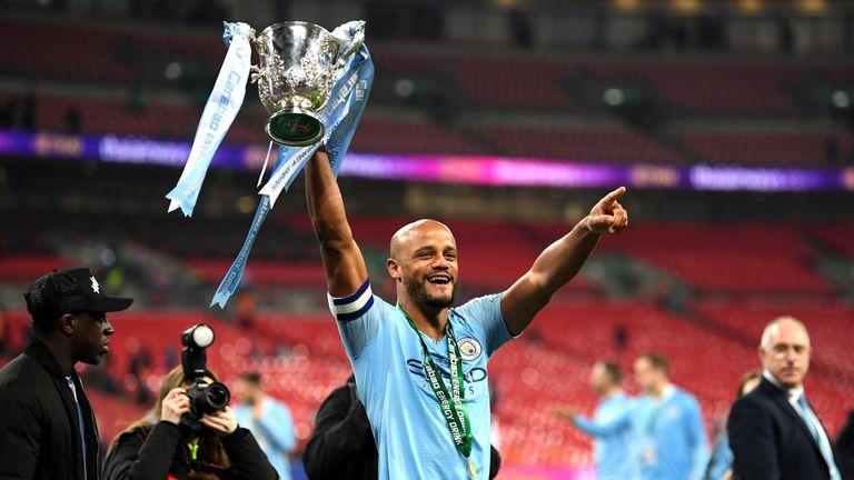 Kompany celebrates winning the League Cup final last month