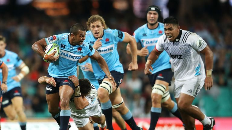 Kurtley Beale looks to get through the Crusaders defence