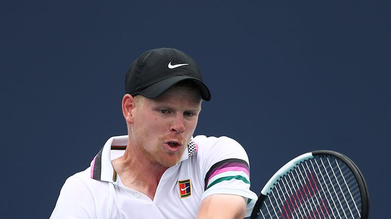 Kyle Edmund of Great Britain in action against Milos Raonic of Canada during day seven at the Miami Open Tennis on March 24, 2019 in Miami Gardens, Florida