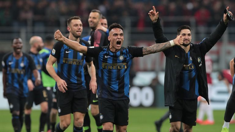 Lautaro Martinez celebrates Inter Milan's win over local rivals AC Milan with his team-mates.