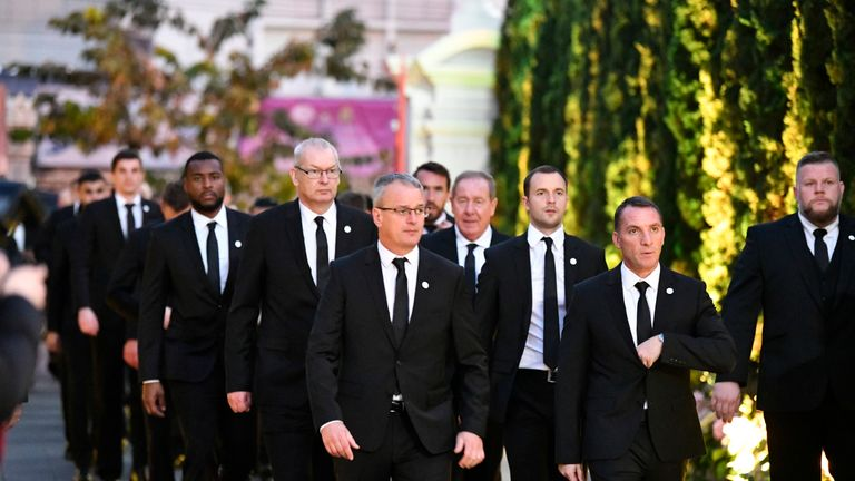 Leicester City staff and players - including manager Brendan Rodgers and captain Wes Morgan - pay their final respects to the club's late chairman Vichai Srivaddhanaprabha ahead of his cremation in Bangkok