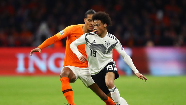 Leroy Sane of Germany is watched by Virgil van Dijk of the Netherlands during the 2020 UEFA European Championships Group C qualifying match between Netherlands and Germany at Johan Cruyff Arena on March 24, 2019 in Amsterdam, Netherlands