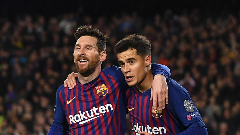 Philippe Coutinho celebrates as he scores Barcelona's second goal with Lionel Messi