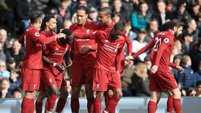 Sadio Mane of Liverpool celebrates with his team after he scores his sides first goal during the Premier League match between Fulham FC and Liverpool FC at Craven Cottage on March 17, 2019 in London, United Kingdom. (