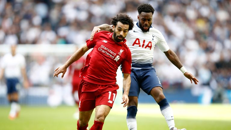 Mohamed Salah and Danny Rose battle for possession during Tottenham's game against Liverpool at Wembley