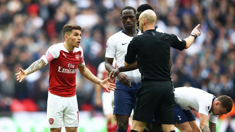 Lucas Torreira is sent off by referee Anthony Taylor after his challenge on Danny Rose