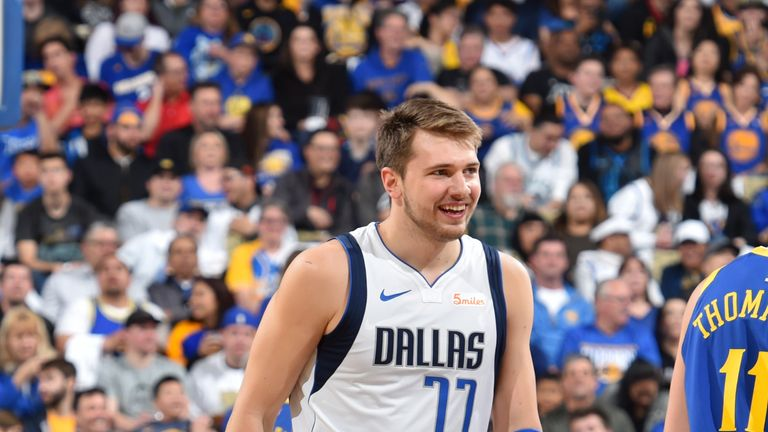 Luka Doncic #77 of the Dallas Mavericks smiles during a game against the Golden State Warriors on March 22, 2019 at ORACLE Arena in Oakland, California.