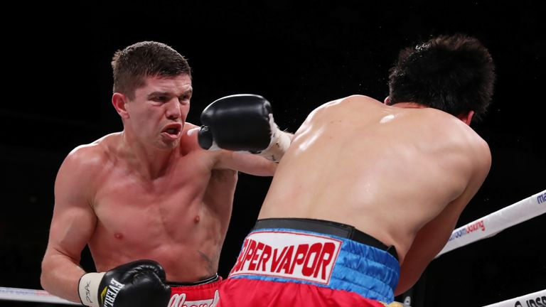 Luke Campbell lands a shot on Adrian Yung during their bout at the Liacouras Center in Philadelphia (Credit:Ed Mulholland/Matchroom Boxing USA)