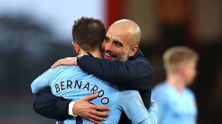 Josep Guardiola, Manager of Manchester City embraces Bernardo Silva of Manchester City following the Premier League match between AFC Bournemouth and Manchester City