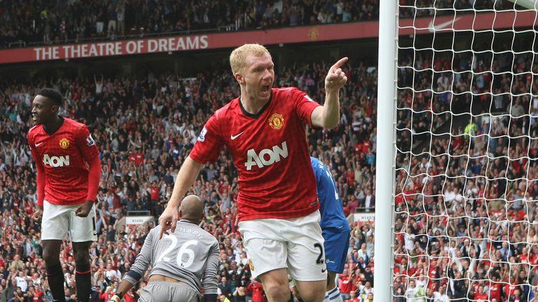 Paul Scholes celebrates scoring for Manchester United against Wigan