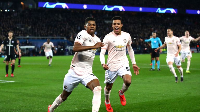 Marcus Rashford celebrates his penalty which sent Manchester United through to the Champions League quarter-finals