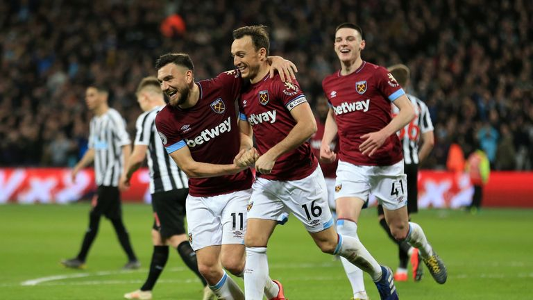 Mark Noble celebrates with Robert Snodgrass after scoring of West Ham's second goal