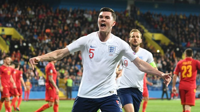 Michael Keane celebrates scoring in England's European Qualifier against Montenegro