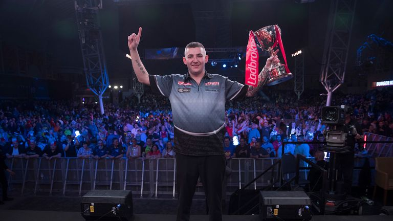 Nathan Aspinall won his first major title with victory over Rob Cross at the UK Open