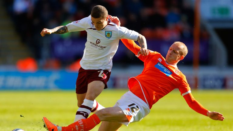 Bishop during his season with Blackpool putting in a tackle on Kieran Trippier
