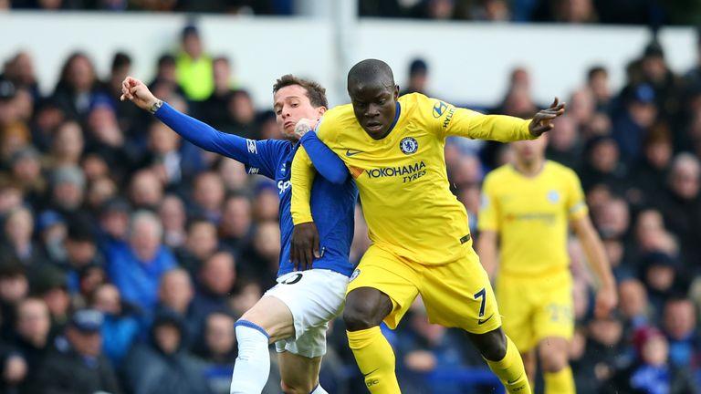Chelsea midfielder N'Golo Kante is challenged by Everton's Bernard