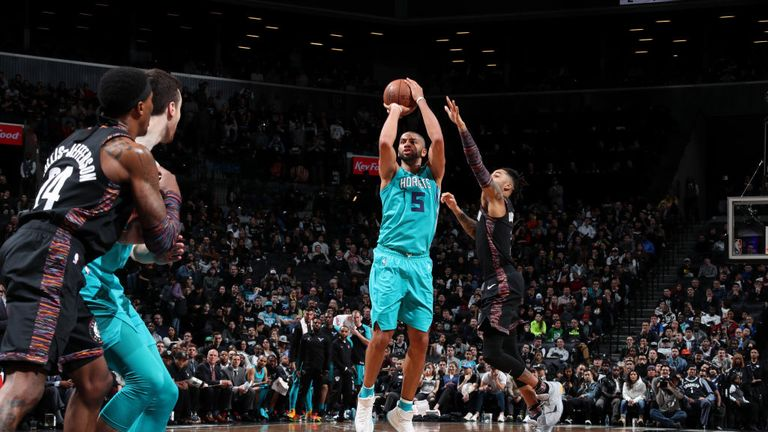 Nicolas Batum of the Charlotte Hornets shoots the ball against the Brooklyn Nets