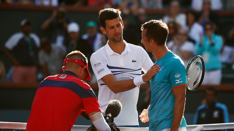 Djokovic congratulates Kohlschreiber at the net