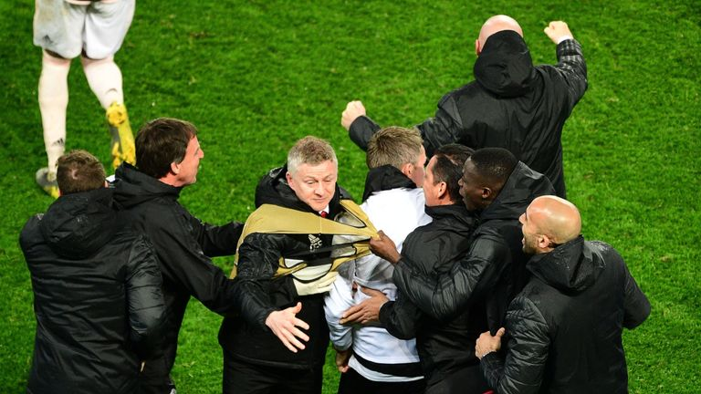 Ole Gunnar Solskjaer is mobbed by Manchester United staff after beating PSG