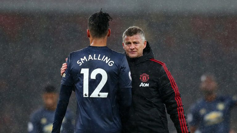 Ole Gunnar Solskjaer with Chris Smalling after defeat to Arsenal