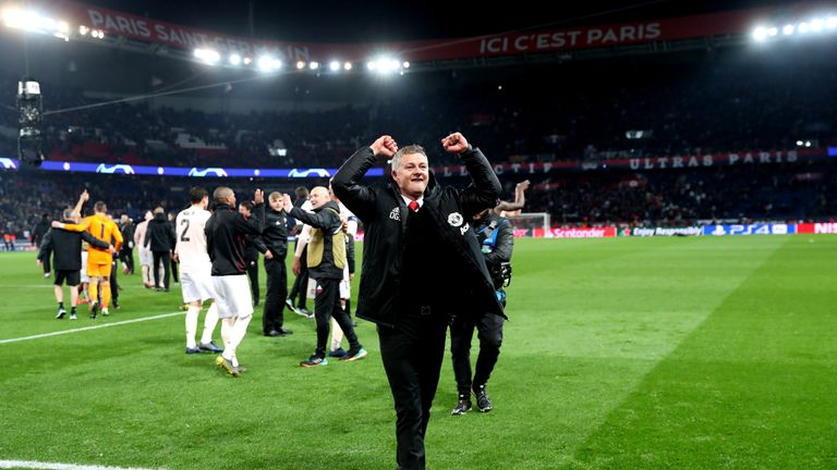 Ole Gunnar Solskjaer celebrates following Manchester United's win at Paris St. Germain in the Champions League.