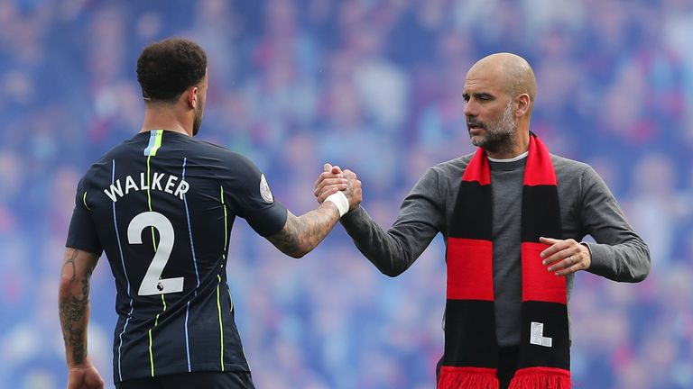 Pep Guardiola shakes hands with Kyle Walker following the 2-0 win over Fulham at Craven Cottage