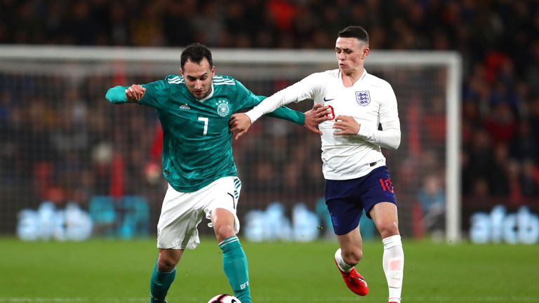 Phil Foden of England tackles Levin Oztunali of Germany during the International Friendly match between England u21's and Germany u21's at Vitality Stadium on March 26, 2019 in Bournemouth, England.