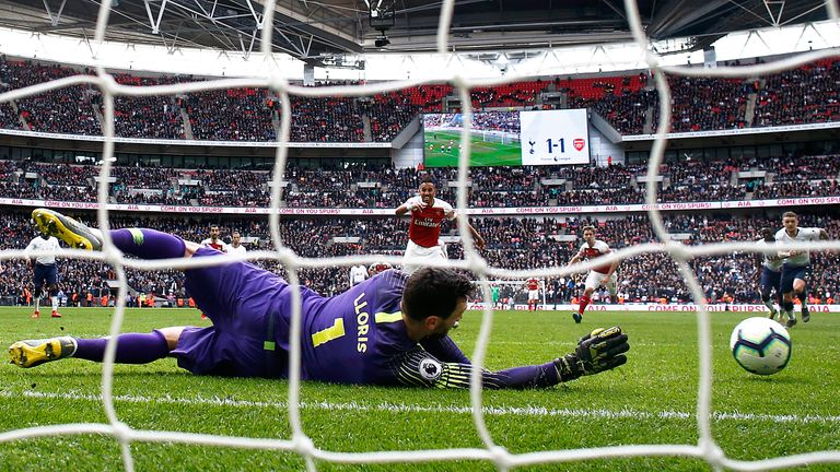 Lloris saved a stoppage-time penalty from Arsenal's Pierre-Emerick Aubameyang
