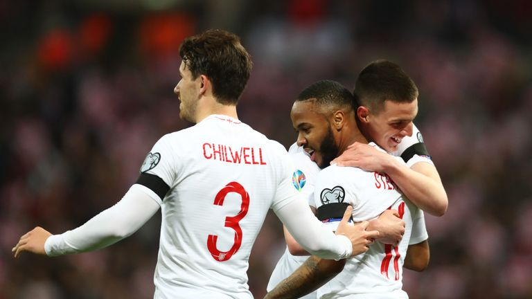 Raheem Sterling of England celebrates as he scores his team's fourth goal and completes his hat trick with Ben Chilwell and Declan Rice during the 2020 UEFA European Championships Group A qualifying match between England and Czech Republic at Wembley Stadium on March 22, 2019 in London, United Kingdom.